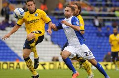 Andrew-Shinnie-shows-determination-to-win-the-ball-from-former-Blues-favourite-Matt-Upson-5746494