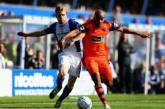 Chris-Burke-of-Birmingham-and-Alex-Baptiste-of-Bolton-challenge-for-the-ball-6142920