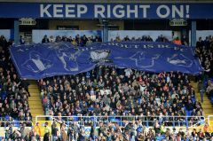 Birmingham-Citys-supporters-pass-a-banner-between-themselves-6789179