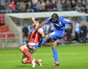 Clayton-Donaldson-scores-his-goal-with-defender-Craig-Morgan