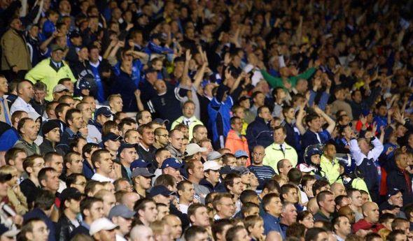 villa-fans-sit-quietly-next-to-the-birmingham-fans